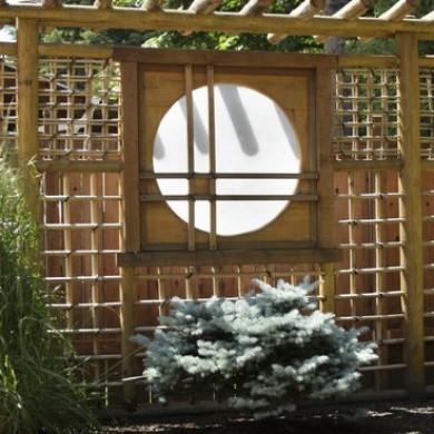 Japanese style bamboo fence with lattic work and stylized window