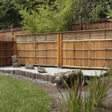 Small Japanese rock garden wtih rocks and bamboo fencing