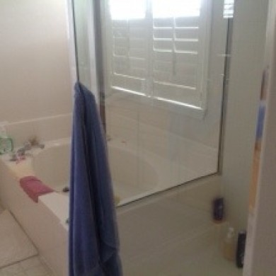 Image of a dated bathroom before a remodel by Patti Marvitz